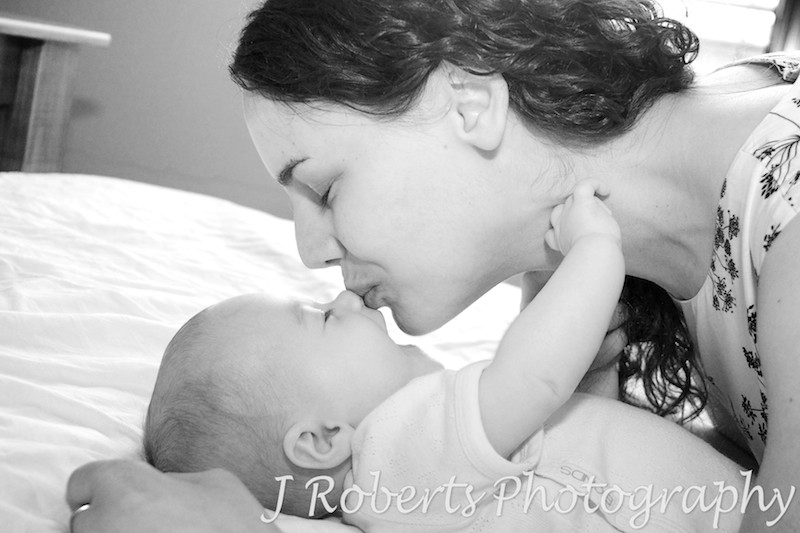 Mother kissing baby on the nose - baby portrait photography sydney