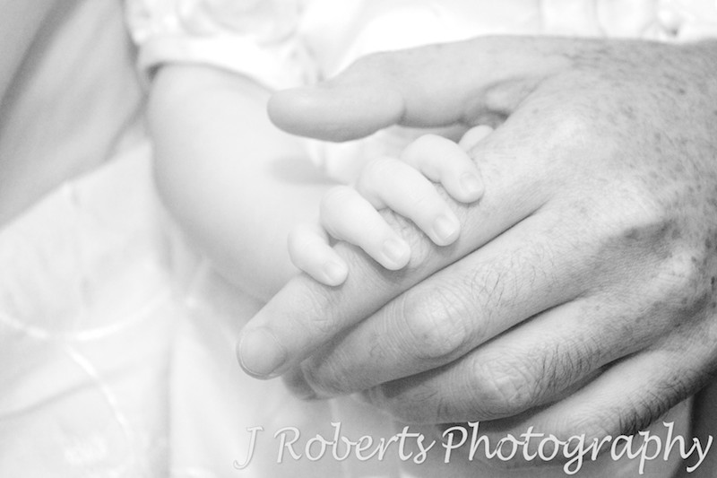 Baby holding her father's finger - baby portrait photography sydney