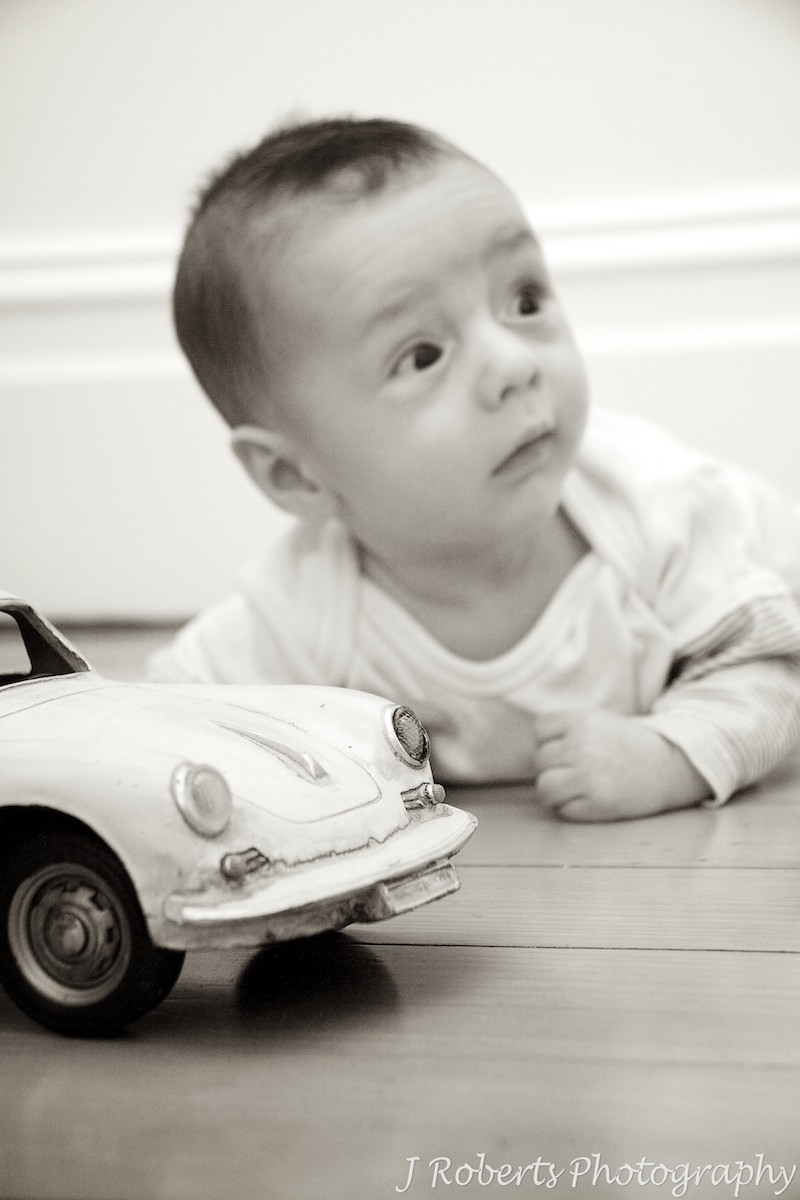 Baby with old volkswagon toy car - baby portrait photography sydney