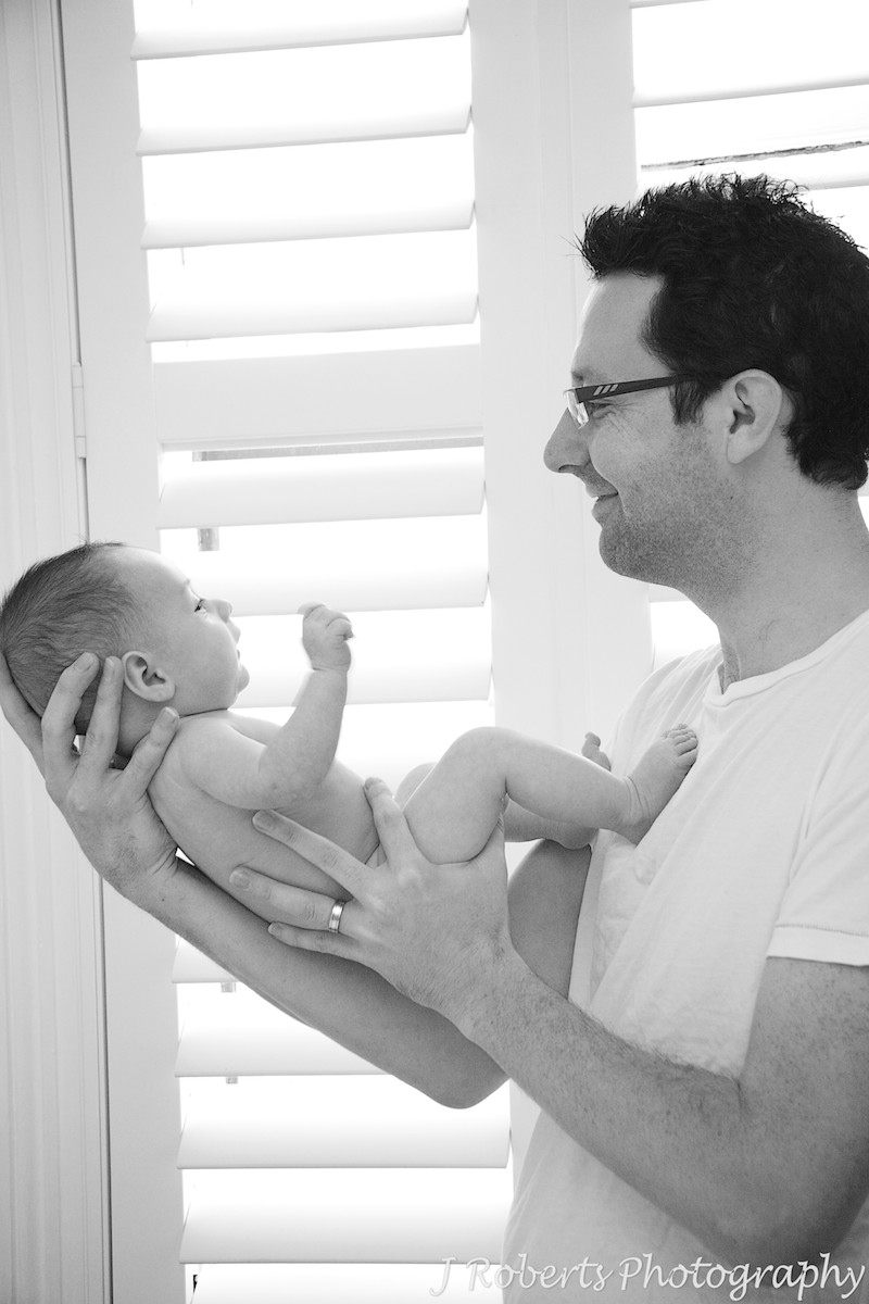 Baby boy in dad's arms - baby portrait photography sydney