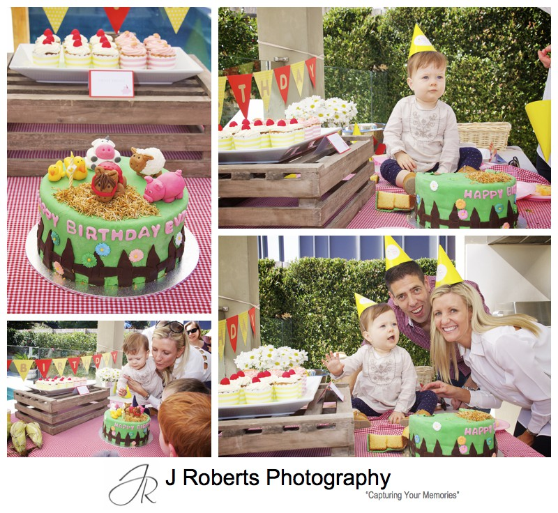 Little girl with her birthday cake on her 1st birthday - party photography sydney
