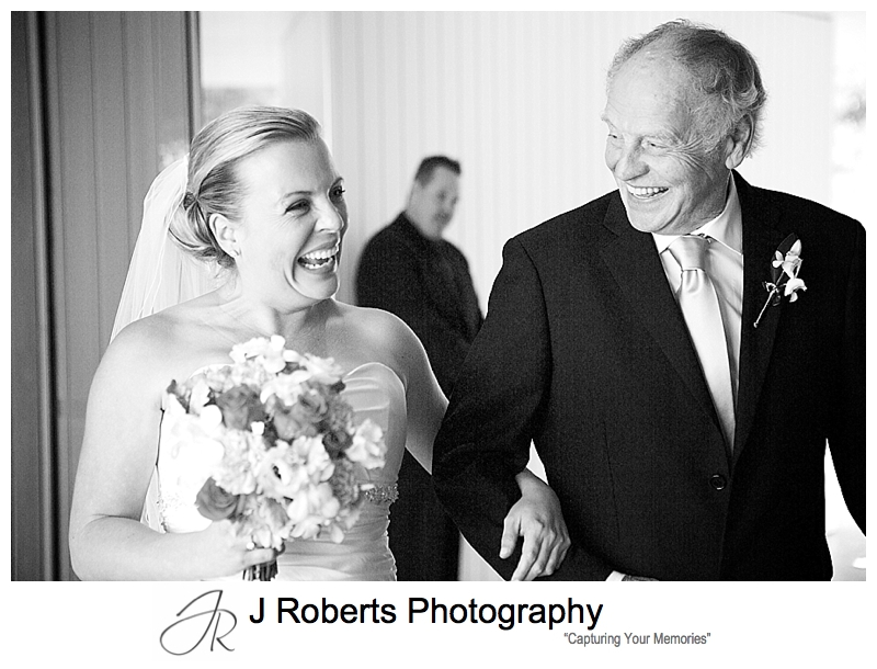 Bride and her father laughing as they walk down the aisle - sydney wedding photography