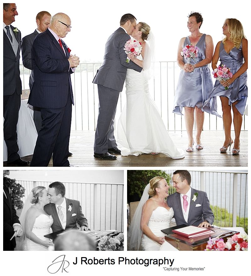 first kiss and signing the registry on the balcony at sergeants' mess mosman - sydney wedding photography