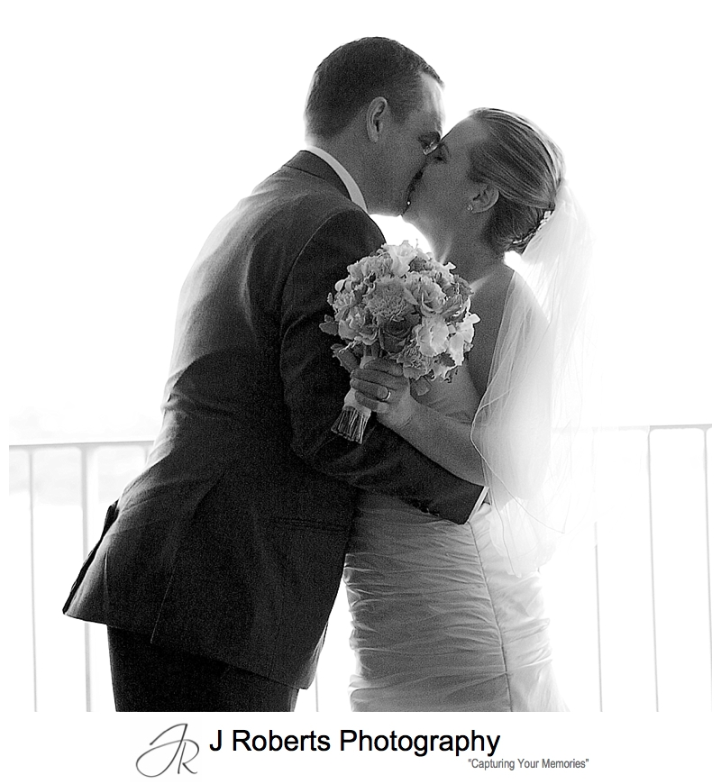 black and white grainy first kiss sillouette - sydney wedding photography