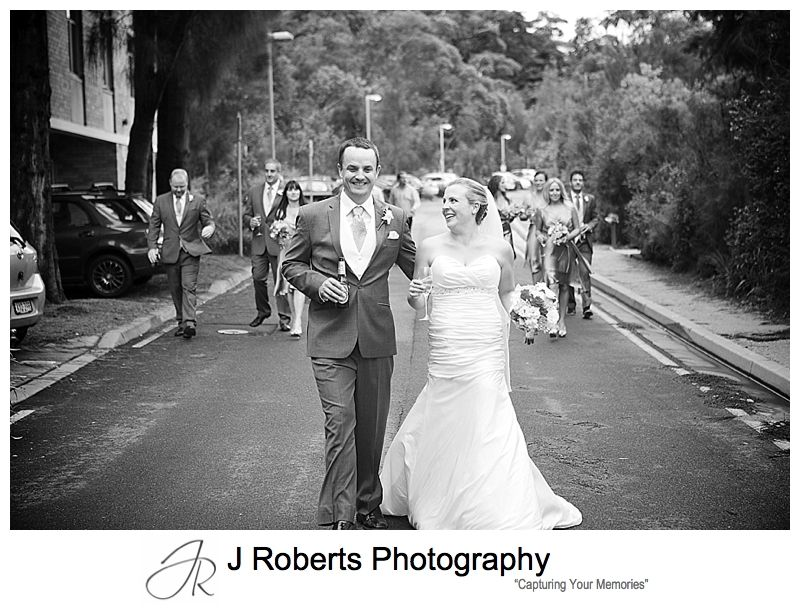 Bridal party walking along the road outside sergeants' mess chowder bay - sydney wedding photography