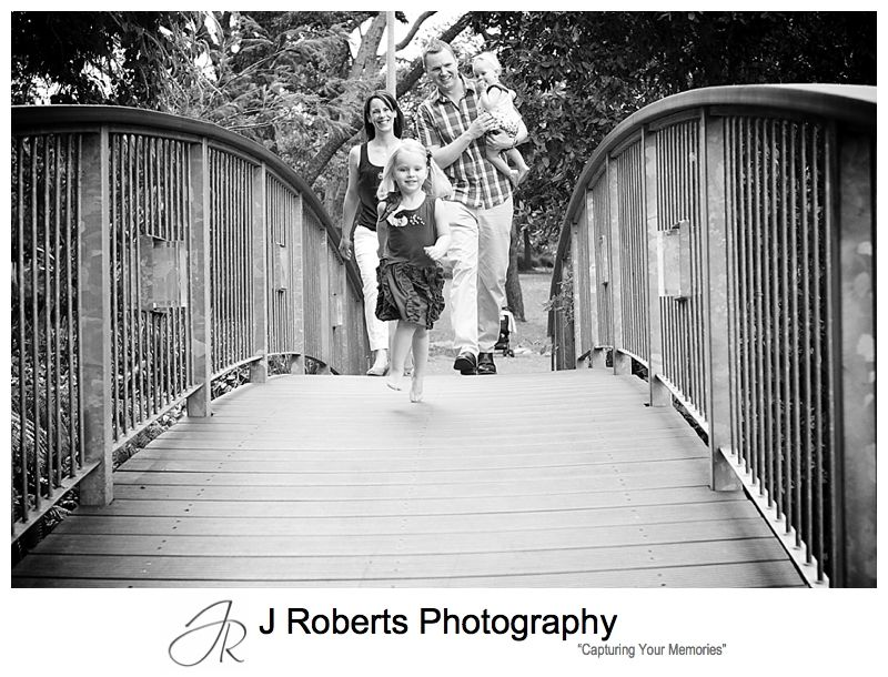 B&W portrait of a family walking across the bridge in Muston Park Roseville - sydney family portrait photography