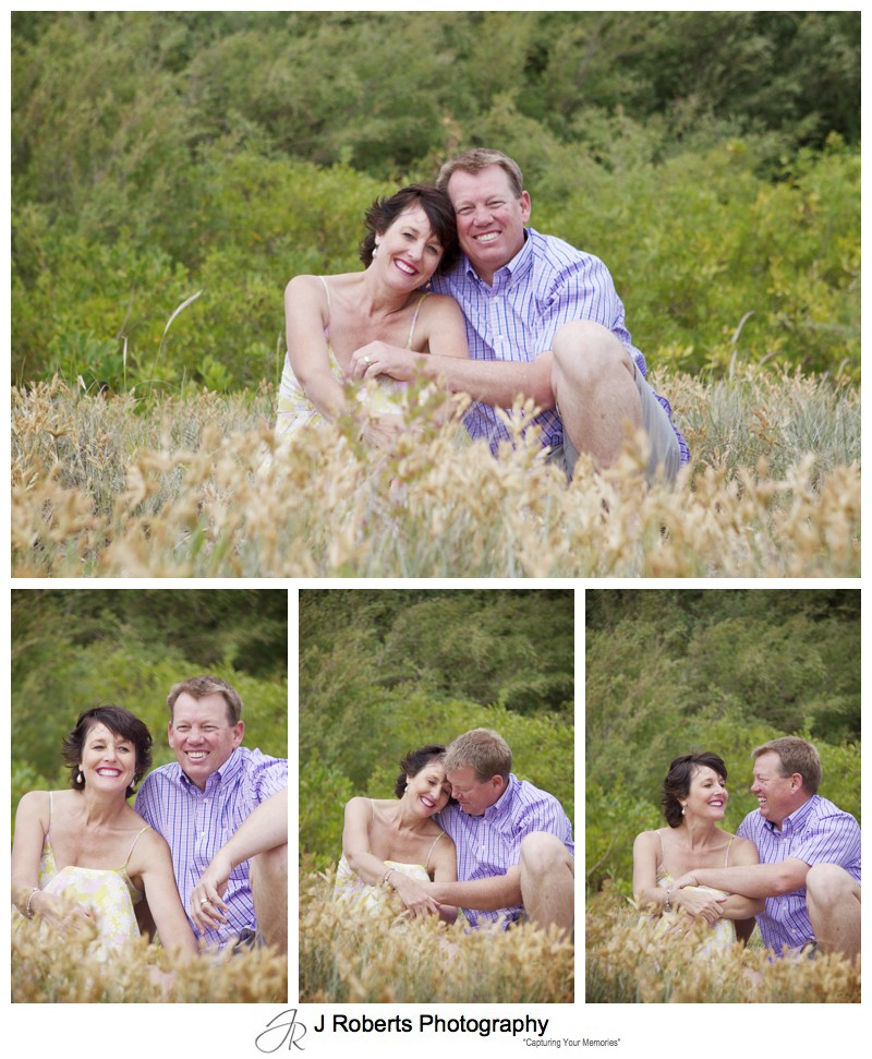 Laughing couple in sand dunes - sydney family portrait photography
