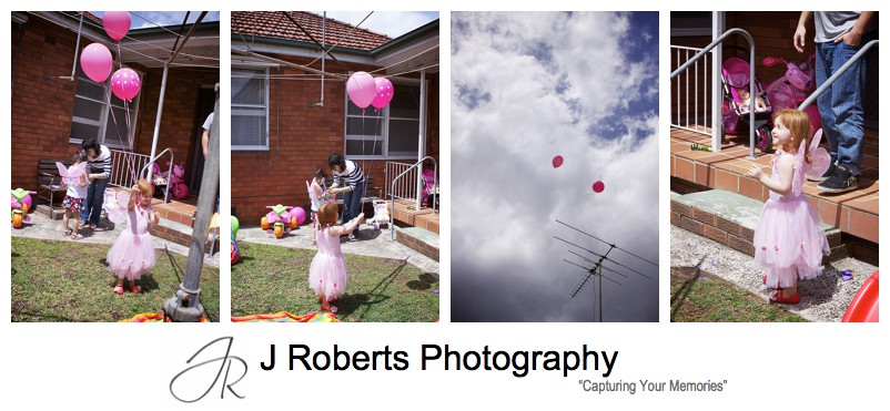 Birthday girl letting go of pink helium balloons at birthday party - sydney party photography