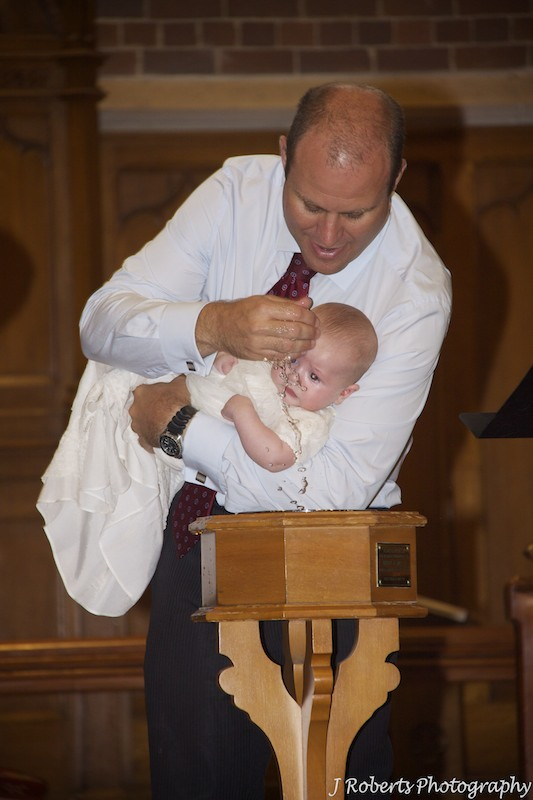 Baby boy being christening - christening photography