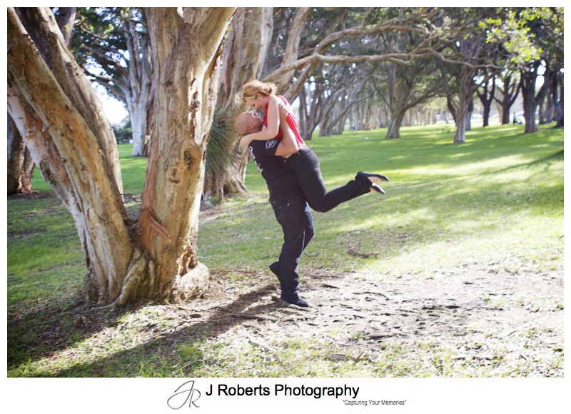 Couple having fun embracing and dancing centennial park - couple portrait photography - sydney