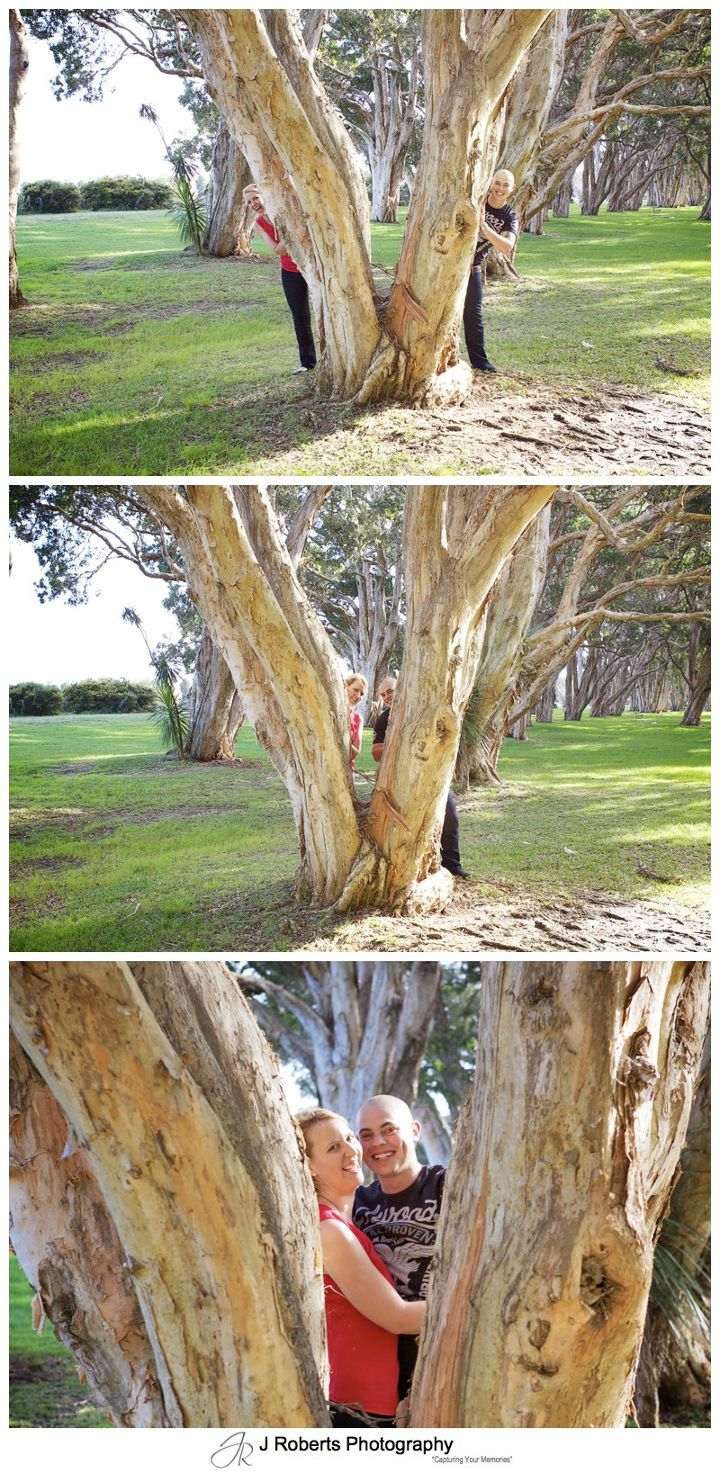 romantic couple hiding in the trees centennial park - couple portrait photography - sydney