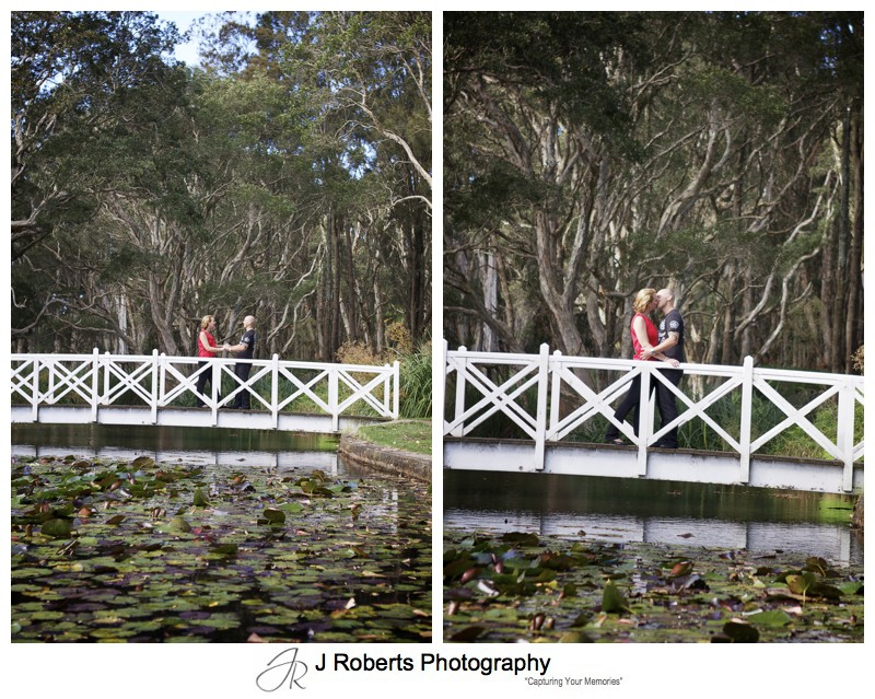 couple kissing on a bridge over lake in centennial park - couple portrait photography - sydney