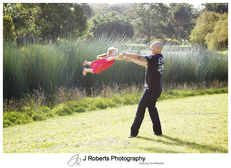 father and daughter in air swing in centennial park - family portrait photography - sydney