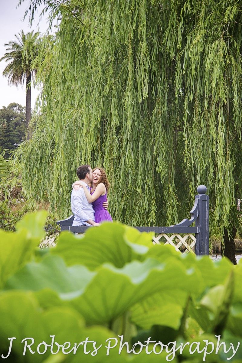 Couple embracing near the lilly ponds at Royal Botanic Gardens Sydney - engagement photography sydney