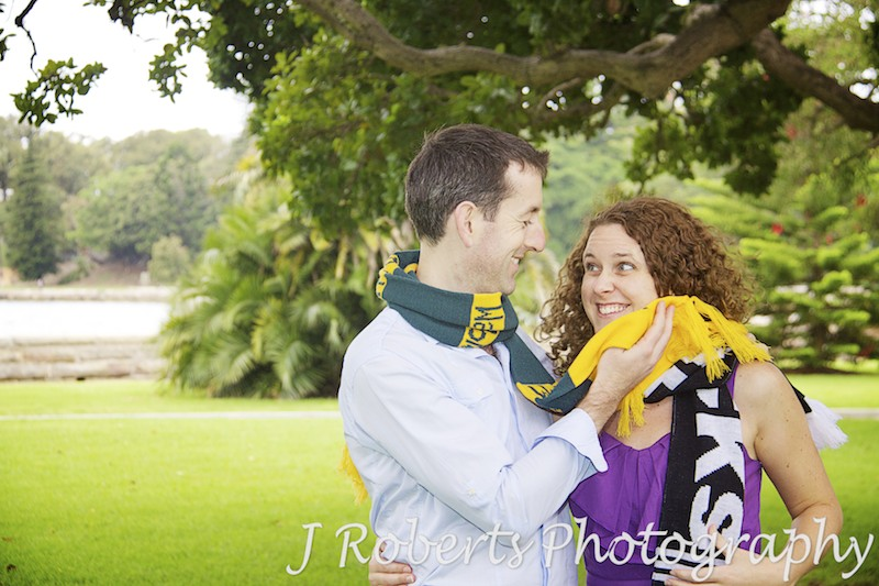 Aussie and Kiwi couple battle it out with rugby scarves - engagement photography sydney