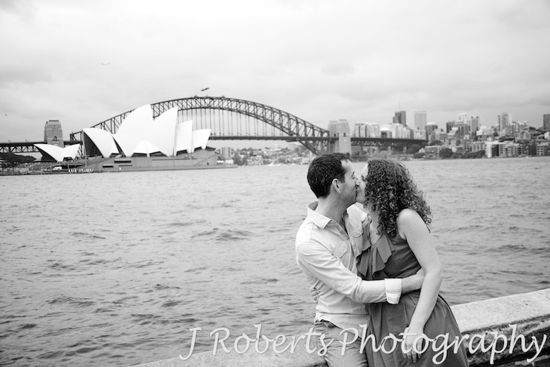 Couple kissing at Mrs Macquarie's Chair Sydney - engagement photography sydney