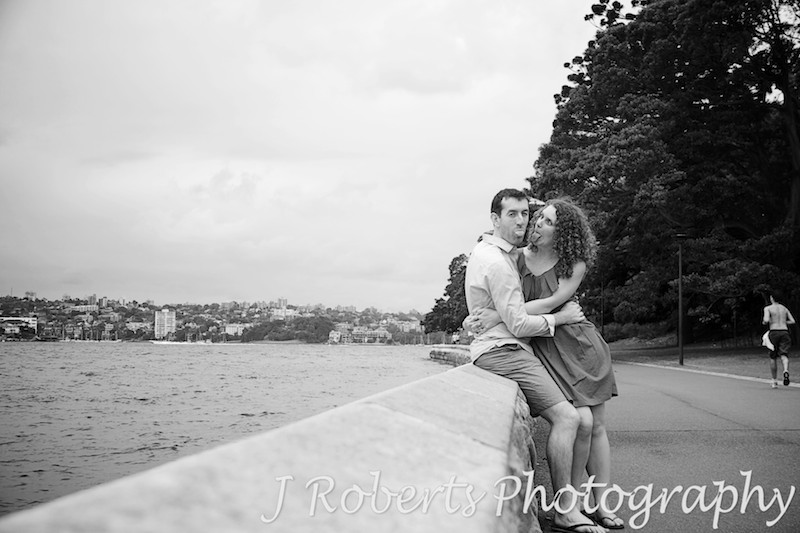 Couple sticking tongues out in fun - engagement photography sydney