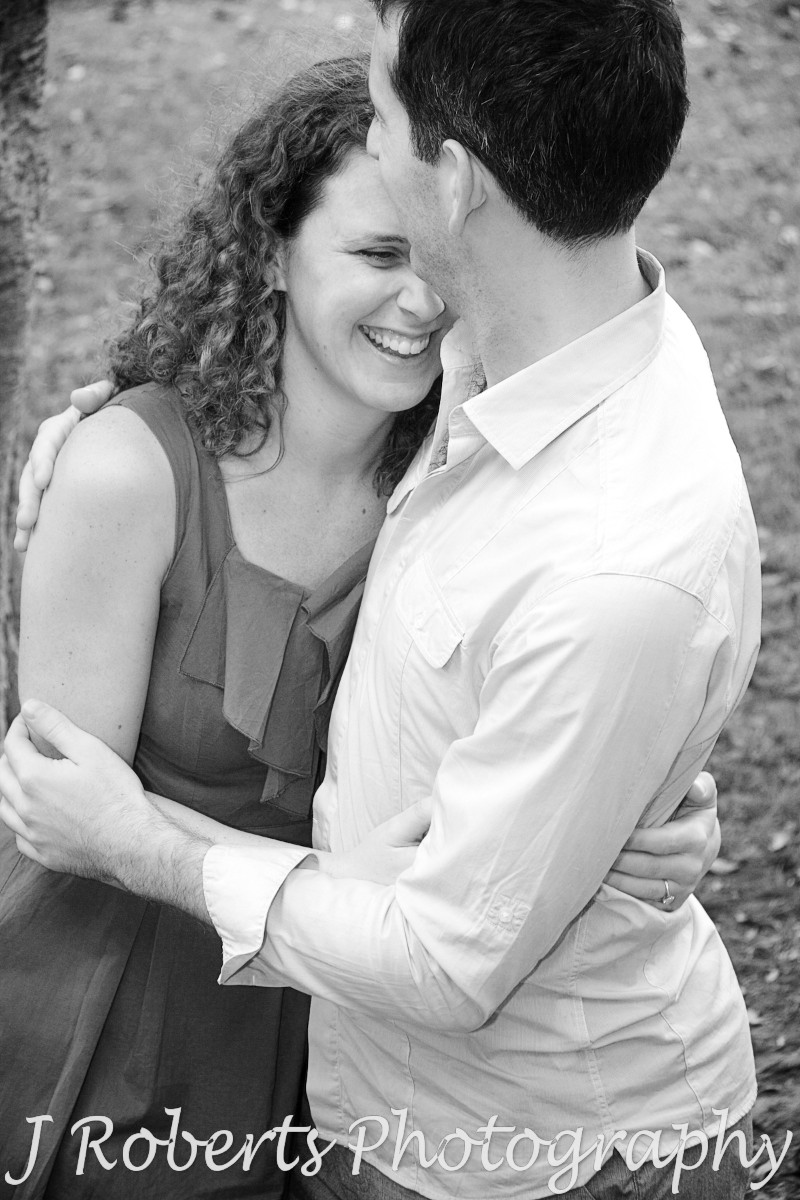 Embracing laughing couple in B&W - engagement photography sydney
