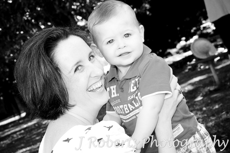 B&W of little boy laughing with his mother - family portrait photography sydney