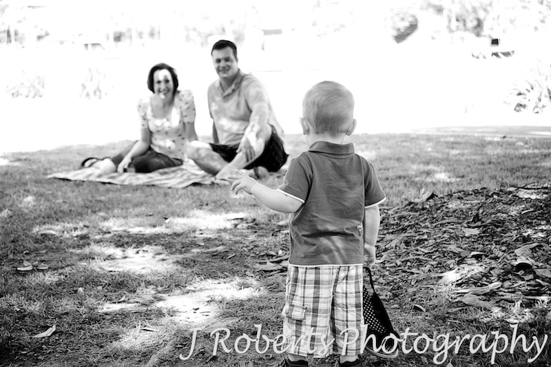 Little boy looking back at his parents - family portrait photography sydney