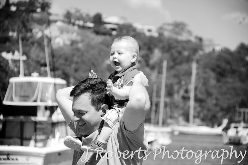Little boy on his dad's shoulders - family portrait photography sydney