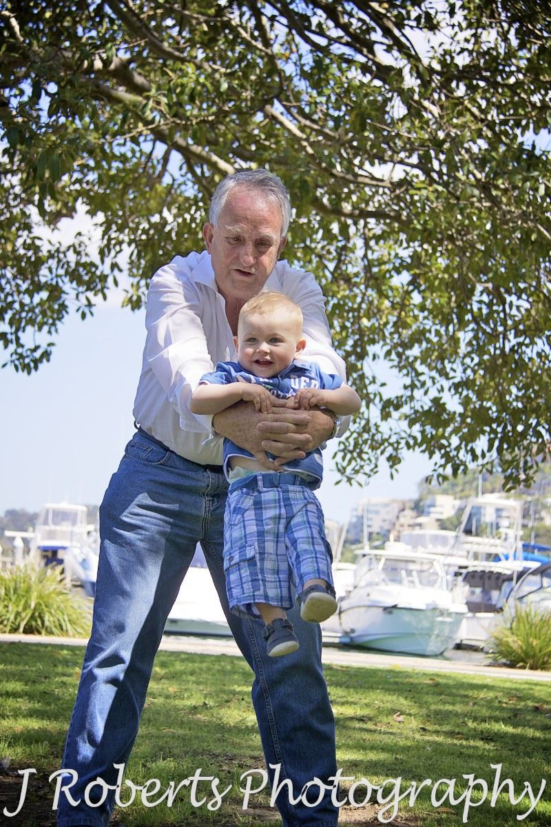 Little boy being swung by his grandpa - family portrait photography sydney