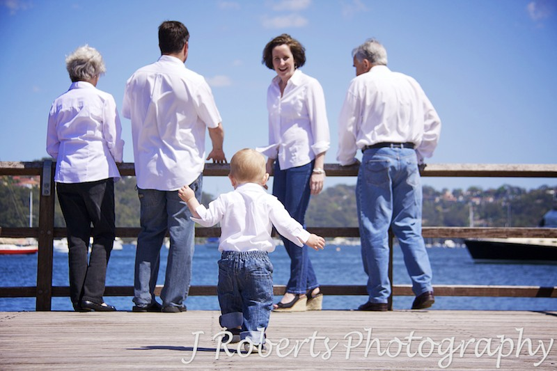Little boy running back to his mother - family portrait photography sydney