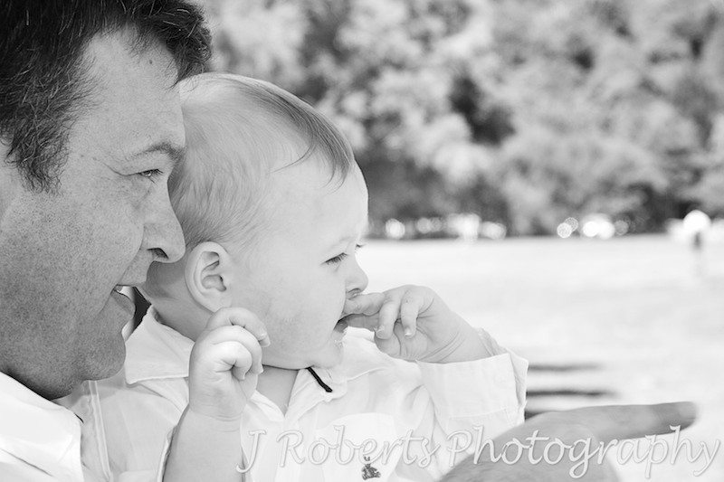 Boy and father looking out to sea - family portrait photography sydney