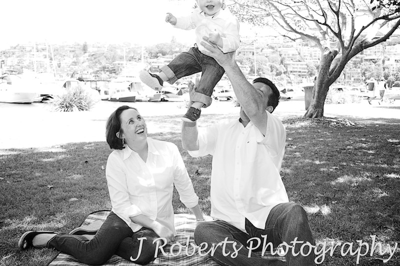 Little boy being thrown into the air - family portrait photography sydney
