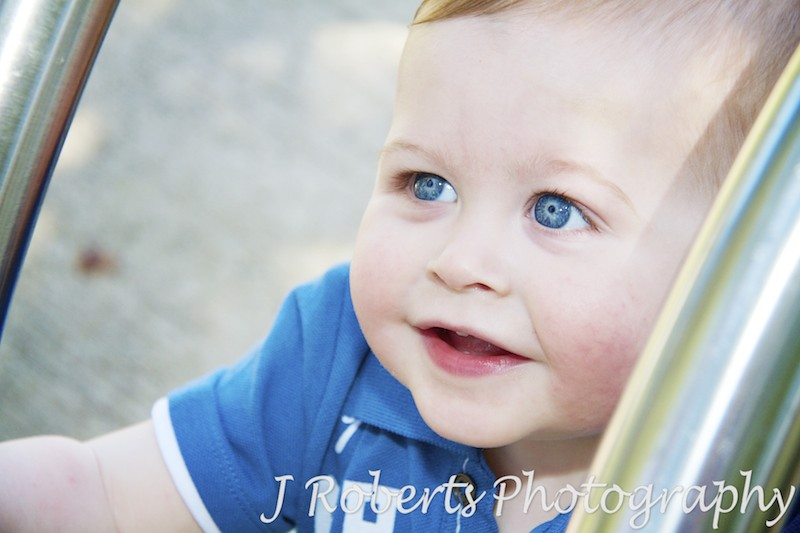 Little boy smiling up at camera - family portrait photography sydney