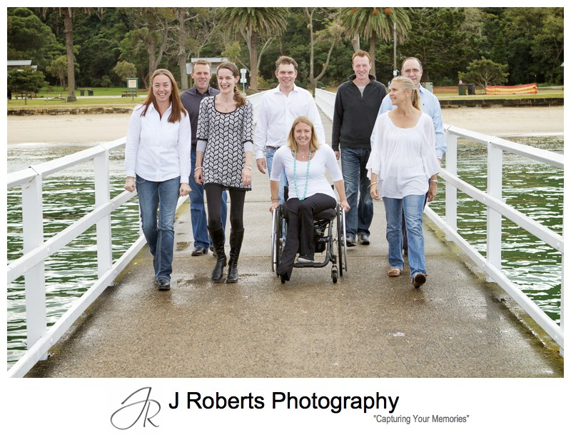 Family group walking along pier - extended family portrait photography sydney