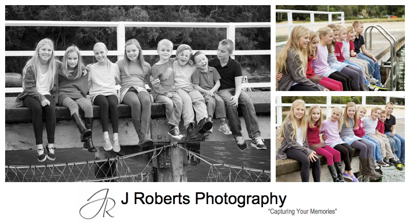 Kids sitting on the pier at clifton gardens - sydney winter family portrait photography