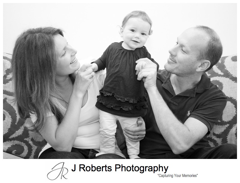 Cheeky little girl with family portraits - family portrait photography balmain