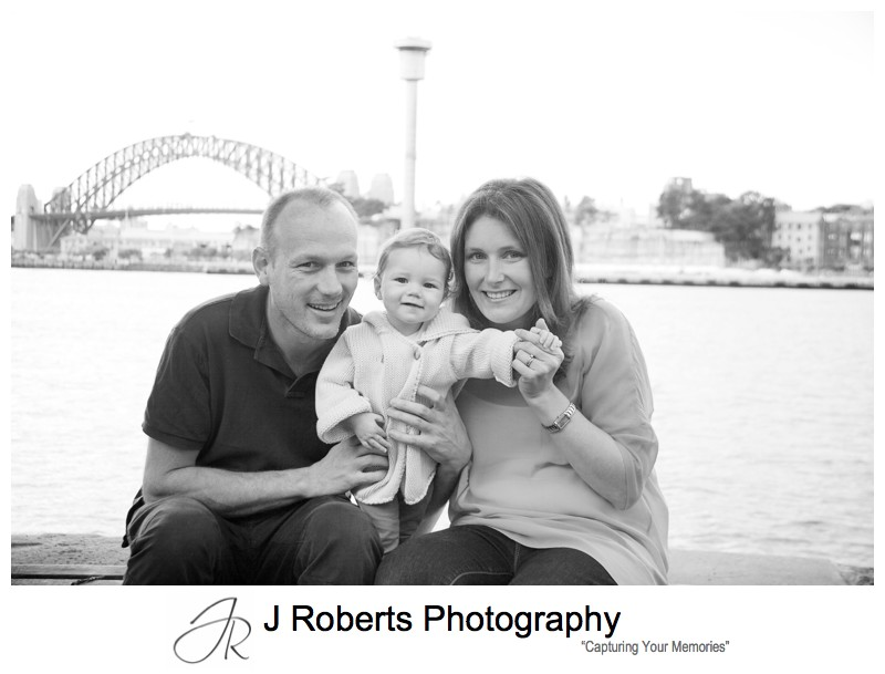 B&W portrait of family with Sydney Harbour Bridge - family portrait photography sydney