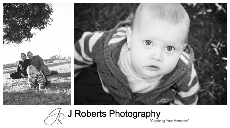 B&W portrait of a little boy looking up at the camera - family portrait photography sydney