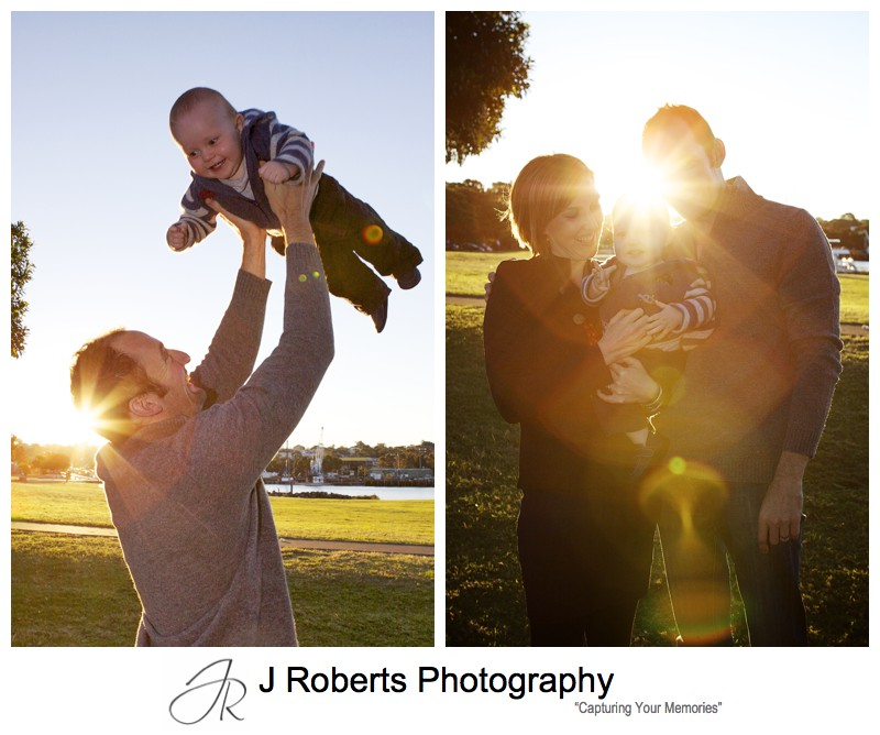 Little boy being thrown up in the air by his dad with setting sun behind - family portrait photography sydney