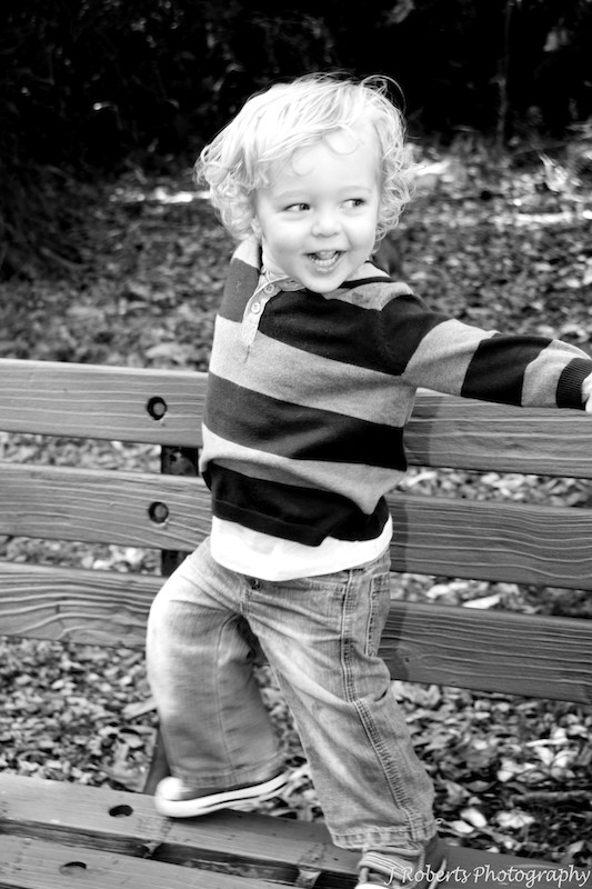 B&W of cheeky little boy - family portrait photography sydney