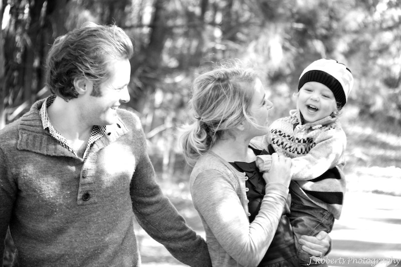 B&W family of three walking in the park - family portrait photography sydney