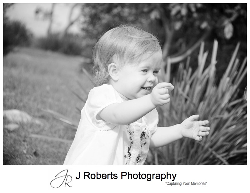 Little toddler chasing bubbles - family portrait photography sydney
