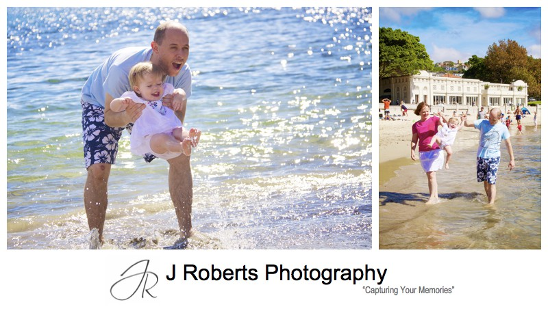 Little girl splashing in the water on balmoral beach - family portrait photography sydney