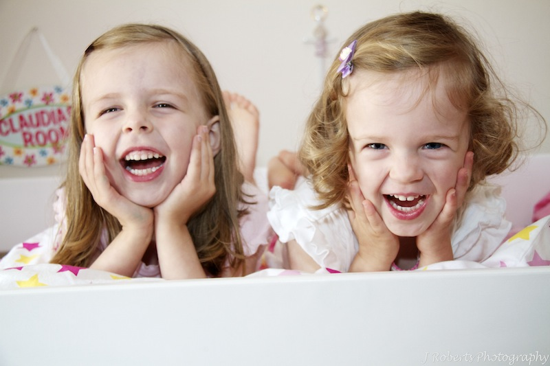 Sisters laughing - family portrait photography