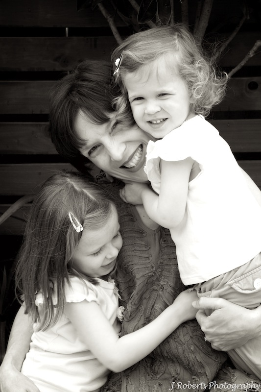 Mother and daughters - family portrait photography