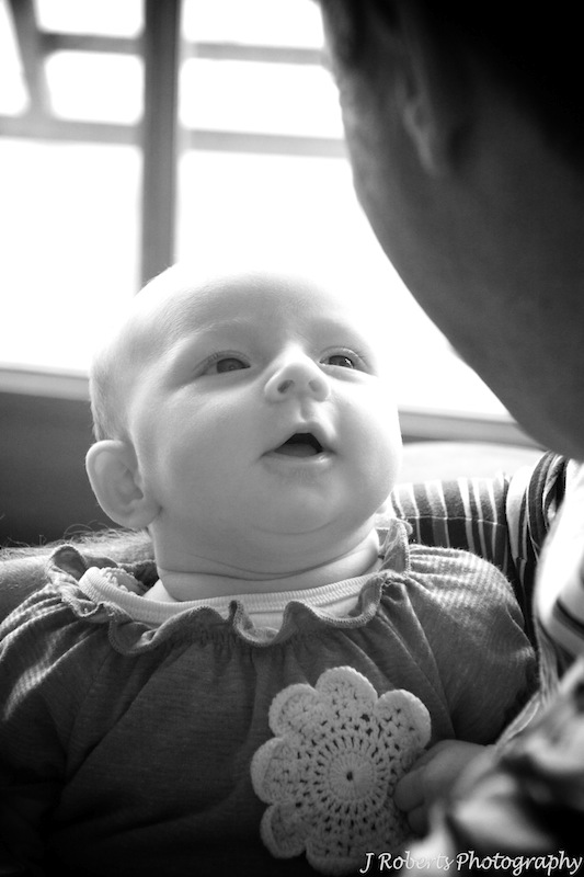Little baby talking to daddy - family portrait photography
