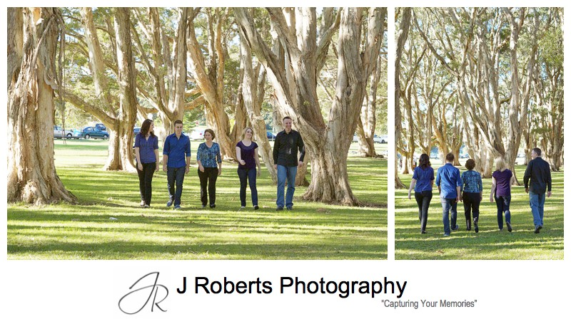 Family walking through the paperbark grove at Centennial Park - family portrait photography sydney