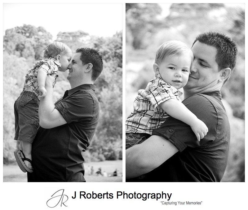 Little boy having cuddles with his dad - family portrait photography sydney