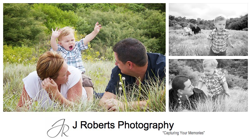 Little boy playing in the sand dunes at Chinamans Beach - family portrait photography sydney