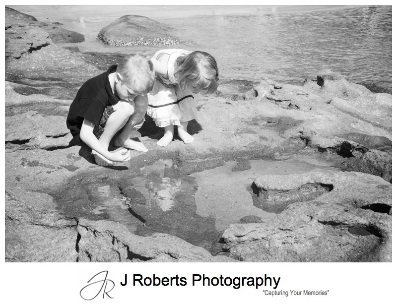 Brother and sister playing in the rockpools - family portrait photography sydney