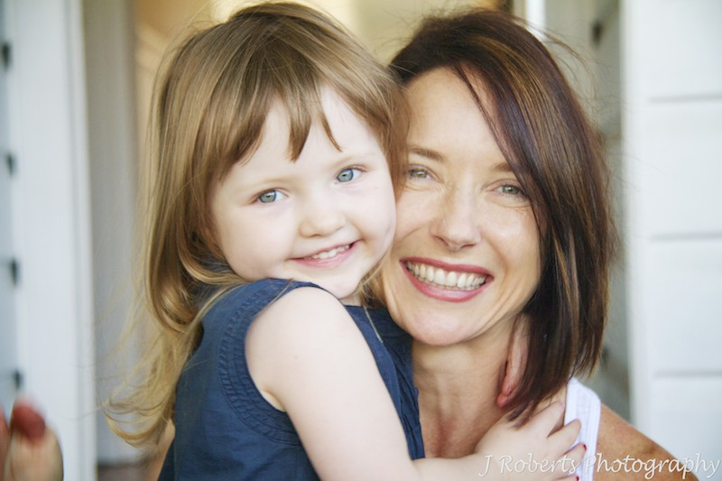 Little girl and mother smiling - family portrait photography sydney