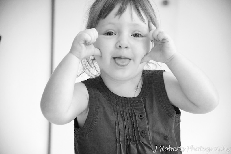 B&W of little girl making faces - family portrait photography sydney