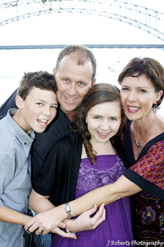 Group hug family of 4 - family portrait photography sydney
